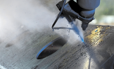Macro waterjet cutting of steel plate.